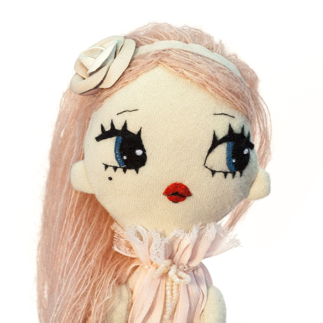 Dollcloud Daniela embroidered fashion doll in pink ruffle dress and rose headband portrait
