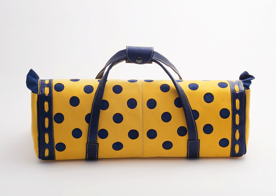 Yellow blue polka dot doll carrier case back